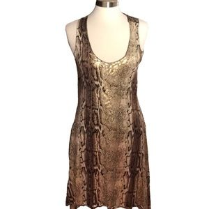 Dresses & Skirts - Sleeveless Reptile Print SharkBite Swing Hem Dress